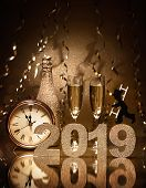 New Years Eve celebration background with pair of flutes, bottle of champagne, clock and a chimney s poster