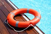 The Red Life Ring Lies On The Wooden Floor Of The Swimming Pool. Life Cycle, Floating Above The Sunn poster