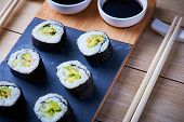 Vegan Sushi Rolls Made With Nori Algae, Sushi Rice, Cucumbers And Avocado poster