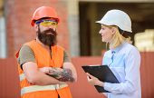 Woman Inspector And Bearded Brutal Builder Discuss Construction Progress. Construction Project Inspe poster