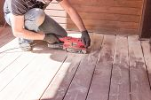 Sanding Hardwood Floor With The Grinding Machine. Repair In The Apartment, Country House, Patio. Car poster