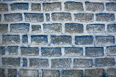 Concrete Wall Of Large Blue Bricks And White Cement. Rough Surface. Rough Texture. poster
