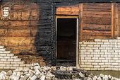 Charred Wooden Parts Of A Burnt House In Countryside poster