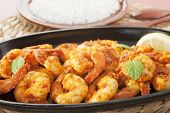 Tandoori Prawns On A Cast Iron Sizzle Platter, Served With Basmati Rice. poster