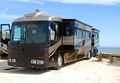 image of motor coach  - photographed motor home camping on the beach in Florida - JPG
