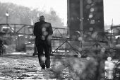 Old Man Walking. Pensioner Lifestyle. Black And White Photo Of An Old Man Walking Lifestyle. Old Peo poster