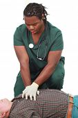 stock photo of cpr  - Medical technician doing CPR - JPG