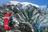 foto of crevasse  - Hiker overlooking the huge crevasses and rugged terrain of the the glacier he - JPG