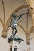 stock photo of perseus  - Perseus holding head of Medusa bronze statue created by Benvenuto Cellini in 1554 and exposed nowadays in Loggia de Lanzi Piazza della Signoria Florence Italy - JPG