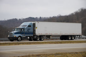 picture of tractor-trailer  - tractor trailer on open highway  - JPG