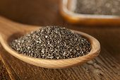 stock photo of salvia  - Organic Dry Black and White Chia Seeds against a background - JPG
