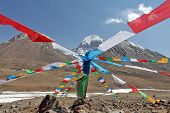 stock photo of buddhist  - Holy Mount Kailash in Tibet and Buddhist prayer flags on foreground - JPG