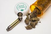 picture of medical marijuana  - Medical marijuana and pipe on white background - JPG