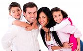 stock photo of piggyback ride  - Happy family portrait smiling together  - JPG