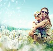 stock photo of mother baby nature  - Portrait of fashionable baby boy and his mother - JPG