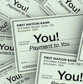 A pile of checks made out to you as payment for work performed, income, commissions, payout or resid