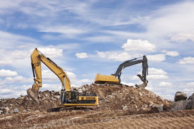 image of backhoe  - Two backhoes excavating at a construction site - JPG