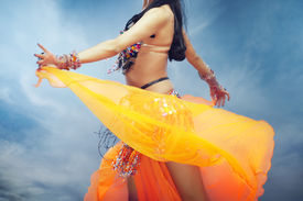picture of belly-dance  - Lady dancing belly dance outdoors in summer - JPG