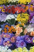 stock photo of lenten  - numerous bouquets of flowers and gifts to be purchased - JPG