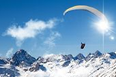 pic of hang-gliding  - two people paragliding in tandem high in the blue sky - JPG