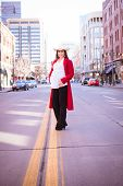 foto of baby cowboy  - Beautiful expectant mother to be pregnant woman cowgirl in urban setting wearing a cowboy hat - JPG