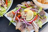stock photo of mahi  - Smoked tuna fish served with pate of mahi mahi and lemon wedge - JPG