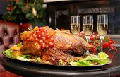 stock photo of roast duck  - Roasted thanksgiving turkey on restaurant table with champagne - JPG