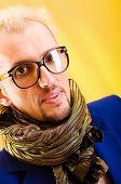 stock photo of feeling stupid  - Man with blue jacket in studio shooting - JPG