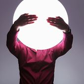 man with big ball of light as a head in the see no evil pose