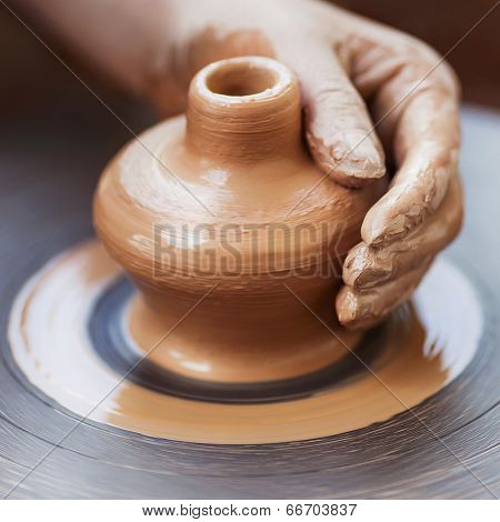 Постер, плакат: Potter Hands Making In Clay On Pottery Wheel Potter Makes On The Pottery Wheel Clay Pot