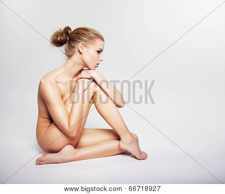 Gorgeous Young Nude Woman Sitting On The Floor poster