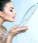 pic of cleanse  - Beautiful Woman with splashes of water in her hands - JPG