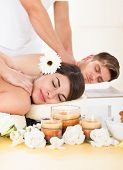 image of acupressure  - Portrait of smiling young couple receiving massage at spa - JPG