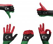 image of libya  - A set of hands with different gestures wrapped in the flag of Libya - JPG