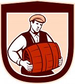 stock photo of keg  - Illustration of a bartender worker carrying keg set inside shield crest on isolated white background done in retro style - JPG