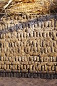 pic of nubian  - Nubian village abstarct texture background of mud brick and straw egypt - JPG