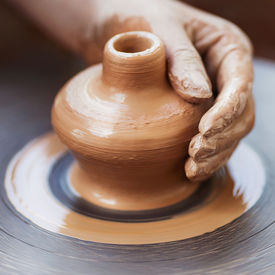 stock photo of pottery  - Potter hands making in clay on pottery wheel - JPG