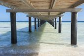 pic of jetties  - Wooden jetty structure going out to sea on tropical beach resort - JPG