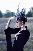 stock photo of wiccan  - sad evil queen in glass crown and sharp nails