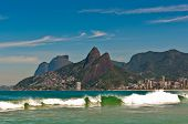 stock photo of olympic mountains  - Wave in the Ocean at Ipanema Beach with Beautiful Rio de Janeiro Mountains on Horizon - JPG