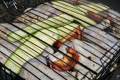 image of marinade  - The marinaded chicken fried on coals on a lattice - JPG