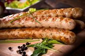 pic of grilled sausage  - Close p to grilled sausages on wooden boardselective focus - JPG