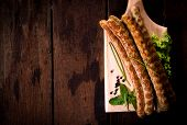 pic of grilled sausage  - Grilled sausages on wooden board from above with blank space - JPG