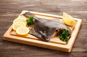 stock photo of flounder  - Fresh raw flounder on cutting board - JPG