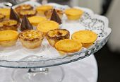 picture of pasteis  - Portuguese egg custard pastry also named Pasteis de nata over glass stand - JPG