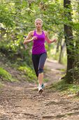 picture of workout-girl  - Pretty young girl runner in the forest - JPG