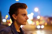 picture of boys night out  - Closeup of a teenage boy in an urban environment at night - JPG