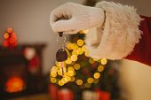 picture of father time  - Hand of father christmas holding car key at home in the living room - JPG