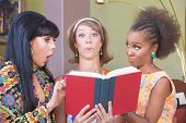 foto of tawdry  - Three cute mature women impressed with a novel - JPG