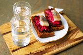 pic of canapes  - Canape herring with beets on rye toasts - JPG